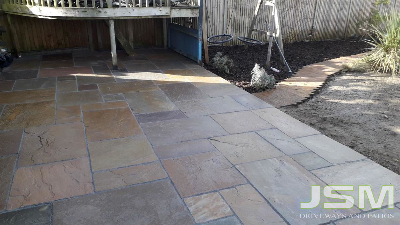 Patio renovation completed by JSM Driveways in Milton Keynes. Installation of an Indian flagstone patio. This was a complete patio overhaul. & Indian Sandstone Patio Installation in Milton Keynes Renovated Garden